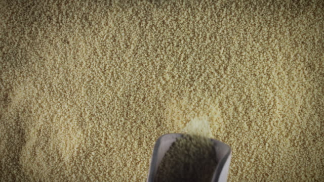 4k Grains Background, Scoop Pouring Couscous from Above Healthy food composition rye grain stock videos & royalty-free footage