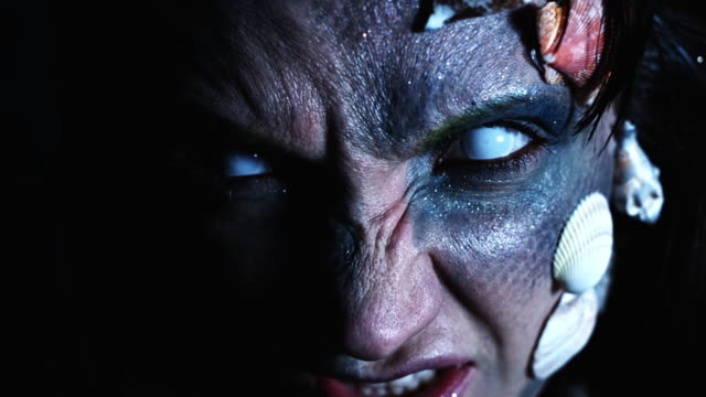 4k Halloween Shot of a Horror Woman Mermaid Opening Eyes and Grinning