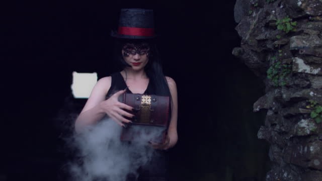 4k Halloween Shot of a Witch Opening a Box with Smoke video