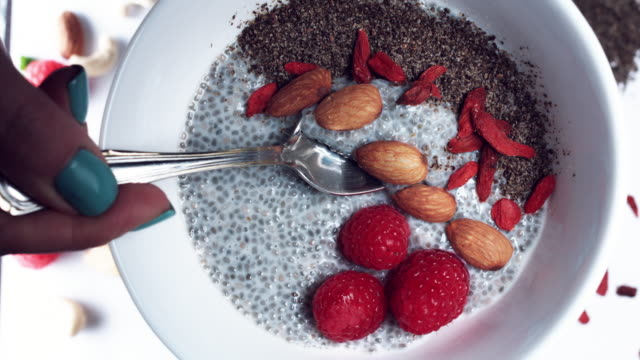 4k Hand Preparing Vegan Chia Pudding with Almond Milk, Berries and Seeds video