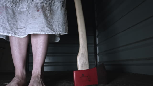 4k Horror Shot of a Dirty Zombie Woman with Axe (reverse) video