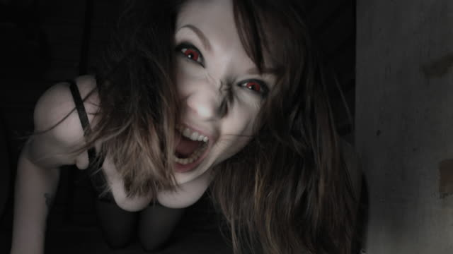 4k Horror Shot of a Sexy Woman Crawling at Camera video