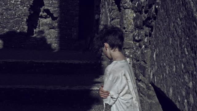 4k Horror Shot of an Abandoned Child Walking Dramatic beside Ruins video