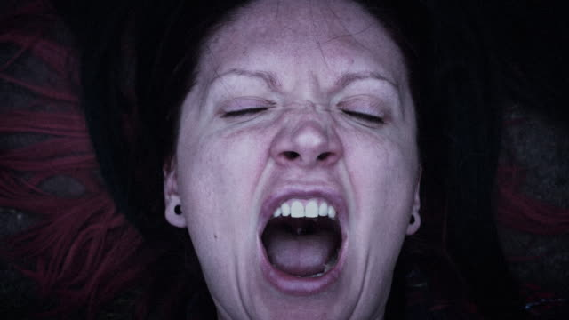 4k Horror Woman Screaming with Hairs in Mouth, edited video