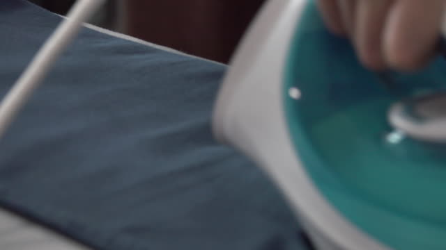 4k: ironing clothes with a steaming iron video