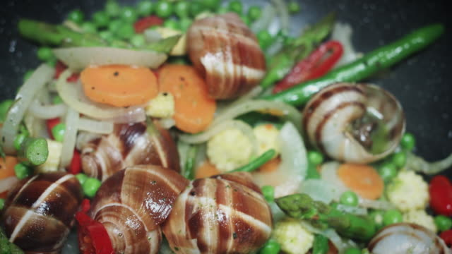 4k Italian Food, Escargots or Snails Frying with Vegetables video