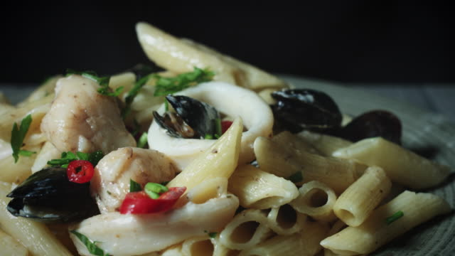 4k Italian Pasta Penne with Seafood Served video