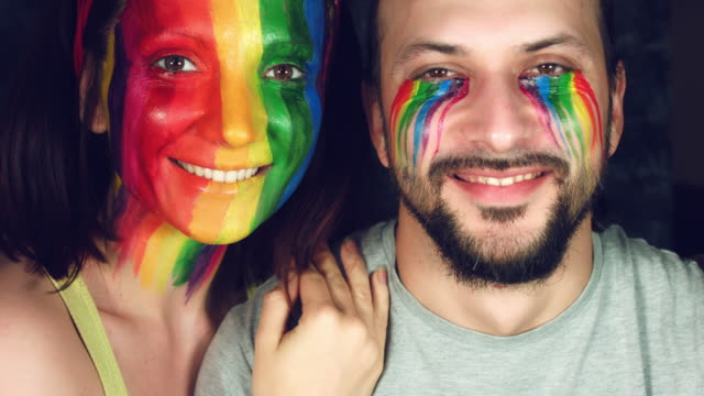 4k LGBT Shot of Rainbow Coloured Couple Faces Smiling Happy video