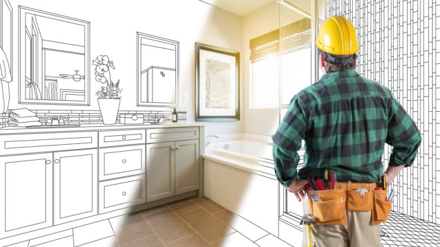 4k looping cinemagraph of contractor in hard hat facing drawing of bathroom design transitioning to photo - bagno video stock e b–roll