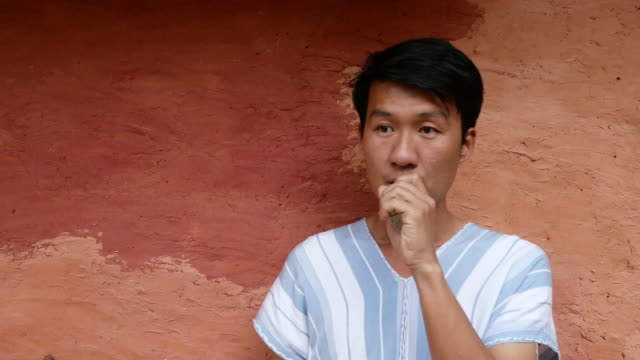 4k man smoking electric cigarette outdoors