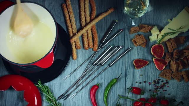 4k Mixed Cheese Fondue Mixing in Pot video