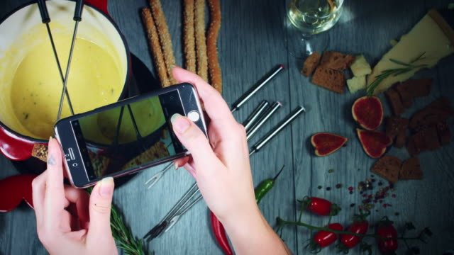 4k Mixed Cheese Fondue Taking Picture on Smartphone video