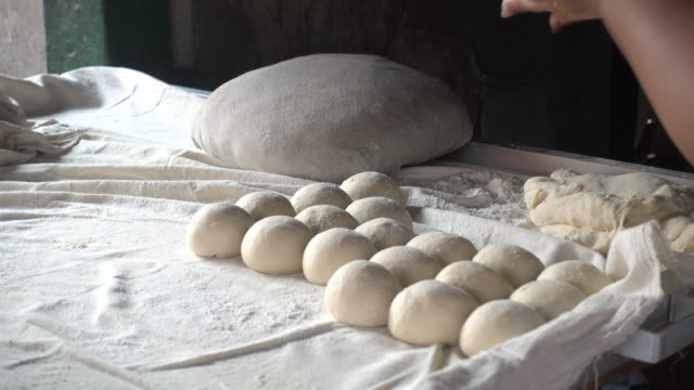 4k Molding dough to make more at a morning market in Kengtung Roti video