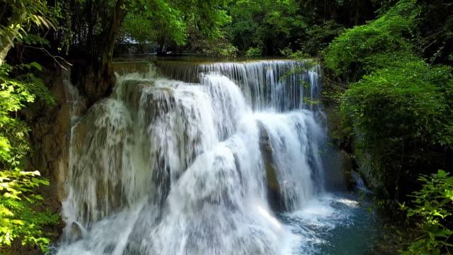 4k movement up motion on beauty waterfall - водопад стоковые видео и кадры b-roll