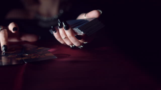 4k Mysterious Shot of Fortune Teller Placing on Table Tarot Cards video