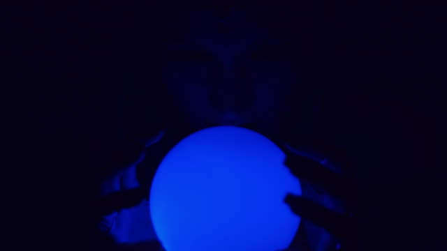 4k Mysterious Shot of Fortune Teller Posing with Hands on Sphere video