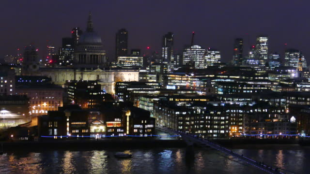 4k Night Footage Of Business Center Cityscape With View Of River Thames In London, UK. video