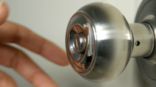4k of Hand Torque door knob to open. video