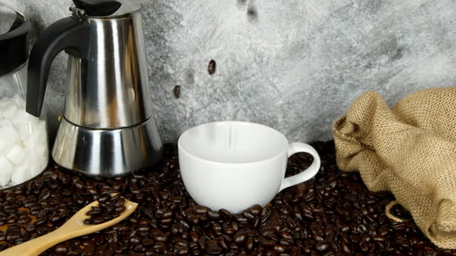 4k of pouring coffee beans in a white coffee cup video