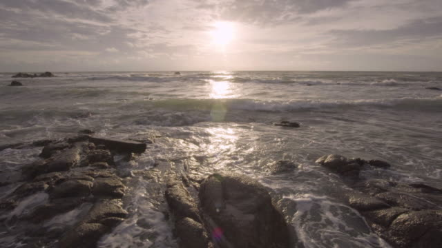 4k of Sea beach and stone with sunset. video
