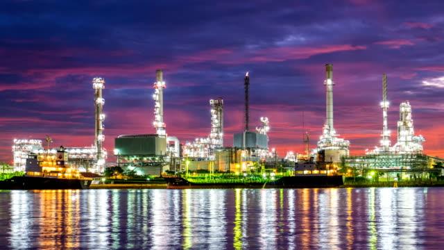 4k oil refinery - petrochemical plant timelapse at sunrise with reflection - gaz filmów i materiałów b-roll