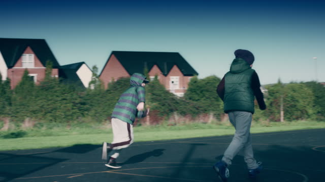 4k Outdoor Shot of Children Playing Basketball on the Field video