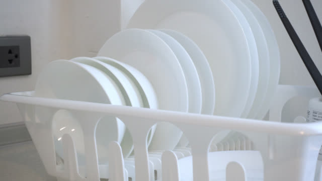 4k Pan shot of white Dish rack 4k Pan shot of white Dish rack crockery stock videos & royalty-free footage