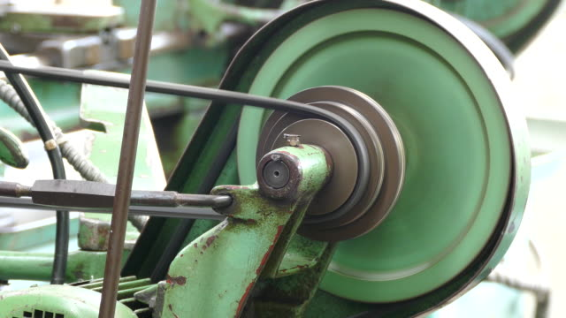 4k: pulley and flywheel of lathe machine. video
