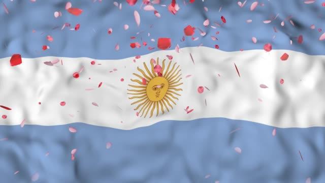 4k Realistic 3D detailed slow motion Argentina flag , Falling Rose petals on flying Argentina Flag Animated Background, video