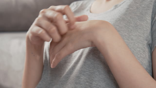 4k resolution Asian Woman scratching on her hand while working at home office. 4k resolution Asian Woman scratching on her hand while working at home office. dry stock videos & royalty-free footage