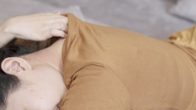 4k resolution Asian Woman using her hand Scratching on his itchy neck.healthcare and medical concept.Eczema skin