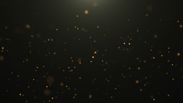vidéos et rushes de 4k résolution christmas background, defocused gold colored particles on black background, slowly falling gold bokeh, glitter lights background, party-social events background, celebration events background, birthday events background, happy new year backg - particule