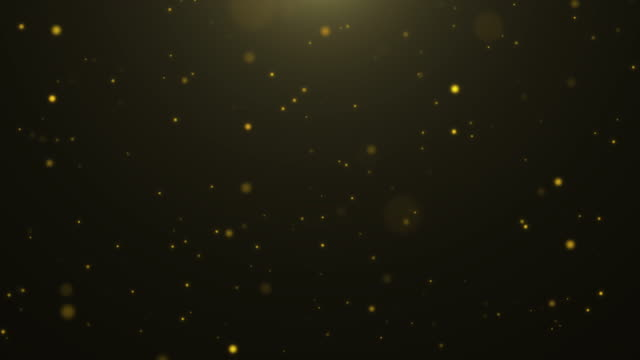 4k resolution christmas background, defocused gold colored particles on black alpha layer background,slowly falling white bokeh, glitter lights background - ciemny filmów i materiałów b-roll