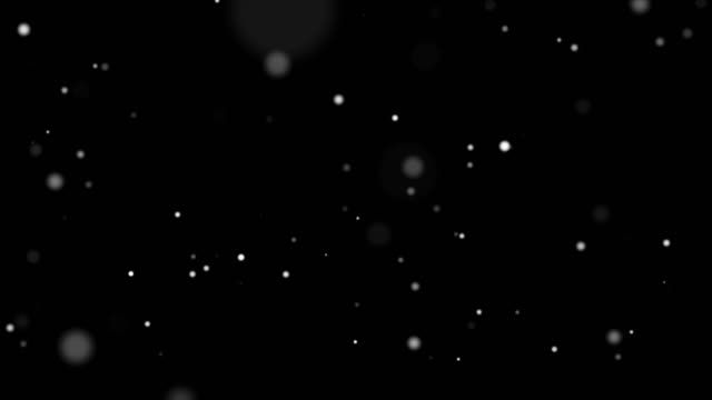 4k resolution christmas background, defocused particles on black alpha layer background,slowly falling white bokeh, glitter lights background - snowflake background stock videos & royalty-free footage