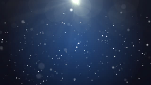 4k resolution christmas background, defocused particles on dark blue background,slowly falling white bokeh, glitter lights background - snowflake background stock videos & royalty-free footage