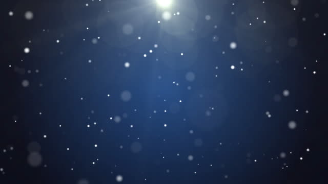 4k resolution christmas background, defocused particles on dark blue background,slowly falling white bokeh, glitter lights background - anniversario video stock e b–roll