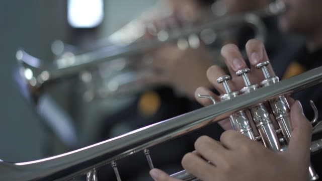 4k resolution Close up hand of trumpet section in wind band
