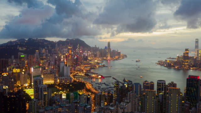 4k resolution drone point of view hyper lapse of hong kong city,aerial view of victoria harbour  at night - hyperlapse video stock e b–roll