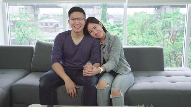 4k resolution sweet lovely asian couple relaxing together at home - happy holidays filmów i materiałów b-roll