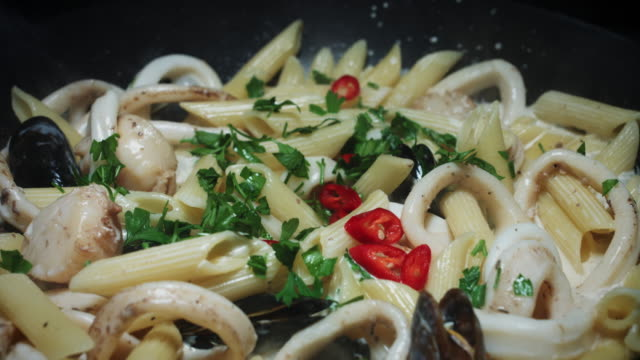 4k seafood with italian pasta cooking in pan - french food stock videos and b-roll footage