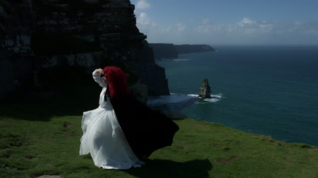 4k Shot of a Redhead Queen on Cliffs of Moher View in Ireland video