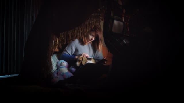 4k Shot of Girl under Blanket Doing a Selfie with her Dog video