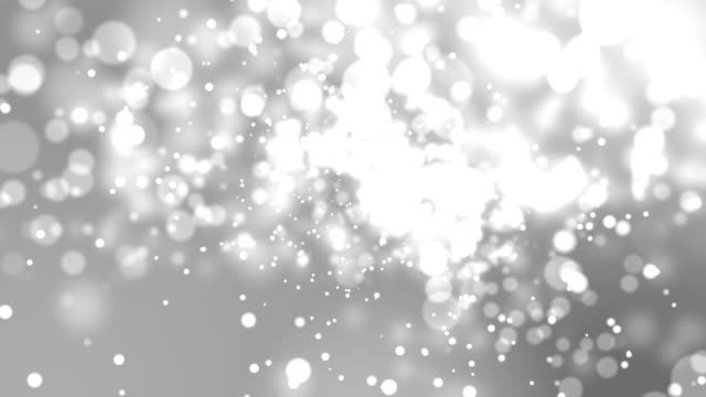 4k Silver Abstract of Bright and sparkling bokeh background 4k Silver Abstract of Bright and sparkling bokeh background silver metal stock videos & royalty-free footage