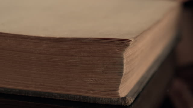 4k Slow motion Turning the pages of an old book