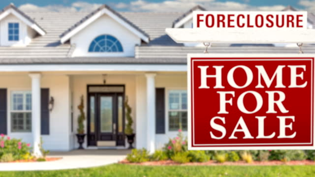 4k slow pan and zoom out of beautiful custom home and foreclosure real estate sign - foreclosure stock videos & royalty-free footage