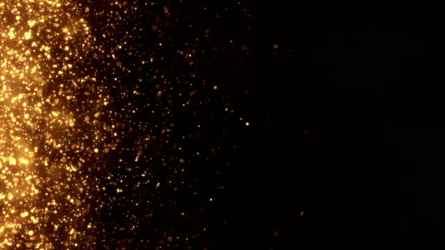 4k small gold particles horizontal movement - background animation - loopable - złoto filmów i materiałów b-roll