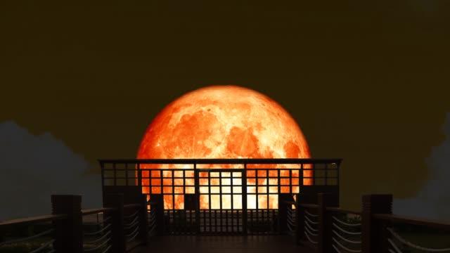 4k Super blood moon rise back on silhouette  bridge on the night sky