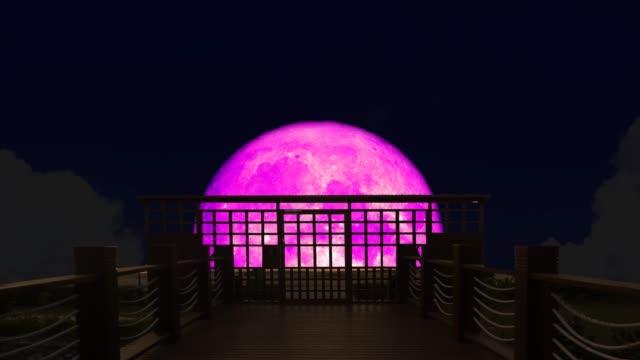 4k Super pink moon rise back on silhouette bridge on the night sky