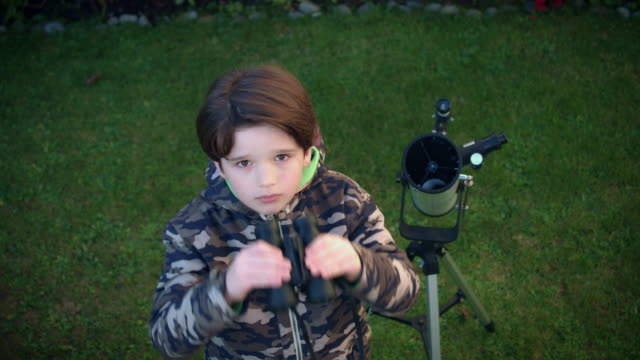 4k Technology and Astrology Child with Binoculars and Telescope Looking at Cam video