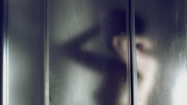 4k Thriller Shot of a Woman in Bath Room Having Shower video